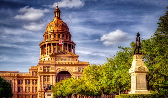 The capitol building and a statue in Austin, Texas